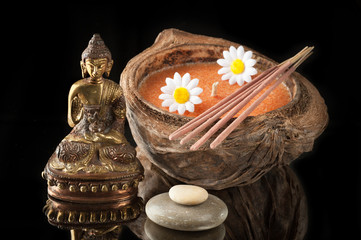 Spa. Buddha statue, stone massage and incense sticks.