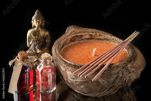Spa. Buddha statue, essential oil, sea salt and aromatic sticks