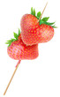 Heart-shaped strawberries on a stick isolated on white