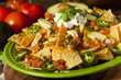Homemade Unhealthy Nachos with Cheese and Vegetables - 60624959