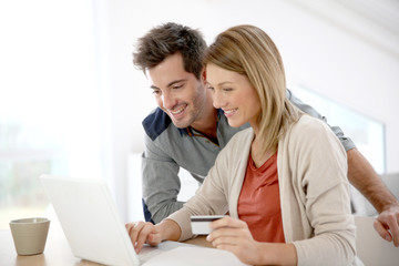 Couple at home buying on internet