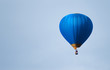 Leinwanddruck Bild - Blue balloon in the blue sky
