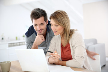 Couple at home working on laptop computer