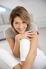 Smiling middle-aged woman relaxing at home