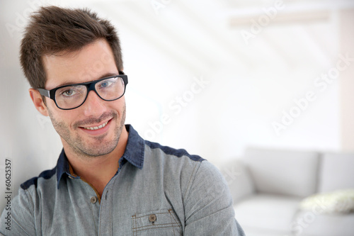 Cheerful handsome man with eyeglasses