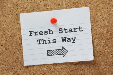 Fresh Start This Way Sign on a cork notice board