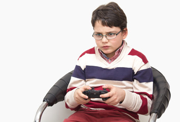 Child with a game controller isolated on white background