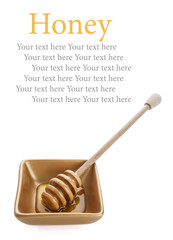 Honey dipper with honey in white bowl on golden background