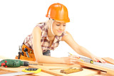Blond female carpenter measuring a batten