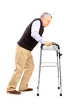 Old man struggling to move with walker
