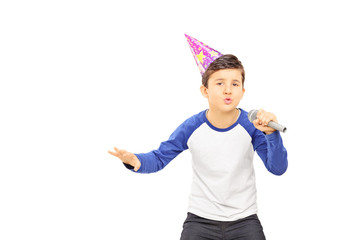 Young  boy with party hat singing on microphone
