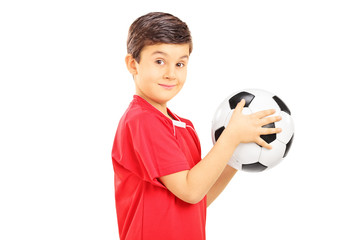Young boy holding a soccer ball