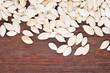 Pumpkin seeds on wooden background