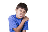 Boy with hurt sprained shoulder - on white background