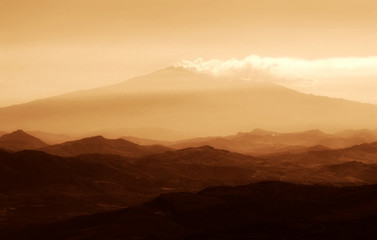 Etna at sunset in golden colors, Sicily, Italy