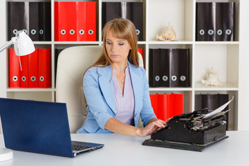 Young woman with notebook and typewriter.