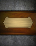gold nameplate on a wooden background. design template