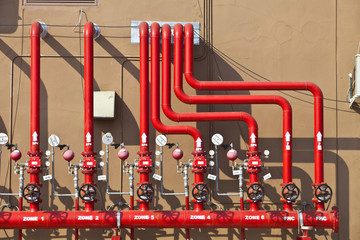 splinker alarm system red water pipe brown wall outdoor
