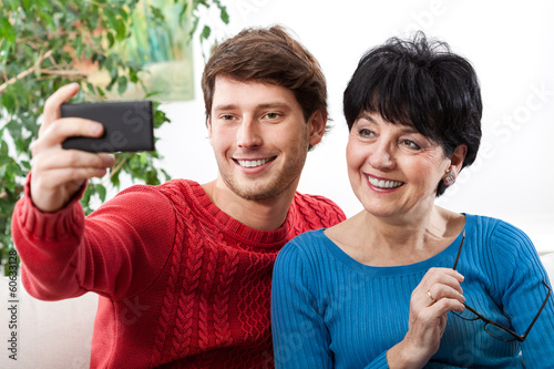 Mother and son taking selfie