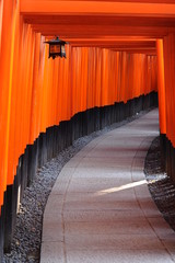 Red Tori Gate at Fushimi Inari Shrine in Kyoto, Japan © kittipak