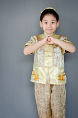 little boy wishing you a happy chinese new year