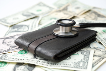 stethoscope above a wallet and US dollars