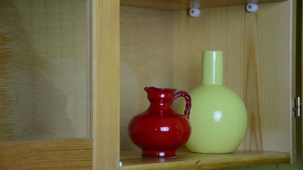 hand put on the shelf decorative clay vases yellow red blue