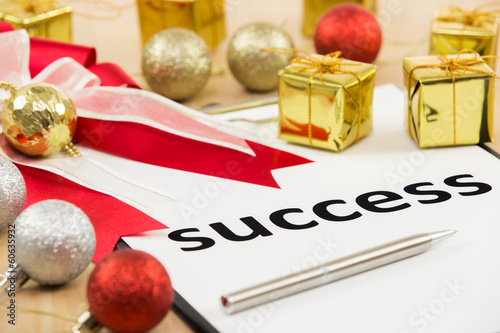 Text success with ribbon and gift