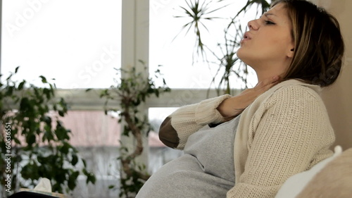 Beautiful woman in pregnant has heartburn