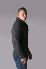 Attractive young man with wool sweater and jeans
