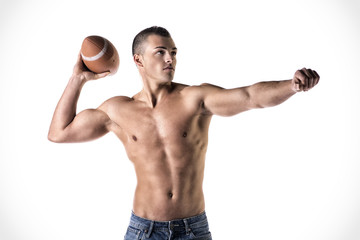 Handsome, young man shirtless, throwing american football ball