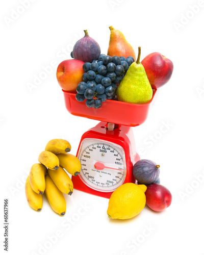 kitchen scales and fruits isolated on white background close-up.