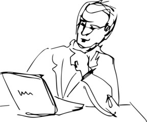 man sitting at table with laptop reading