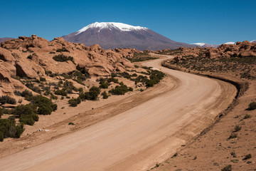 Sandy curve road to the mountain, Bolivia