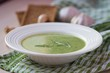 Green garlic cream soup with leaves rukola, arugula, healthy