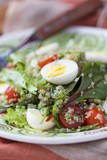 Healthy quinoa salad with tomatoes, avocados, eggs, herbs