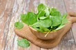 Fresh spinach in a wooden bowl