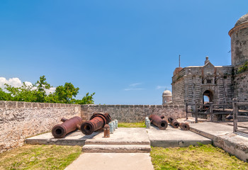 Old weathered cannons and shots exposition
