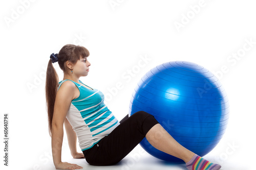 Pregnant woman is doing exercises
