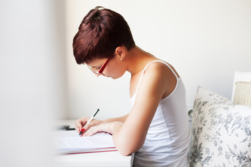 young woman learning and preparing exam