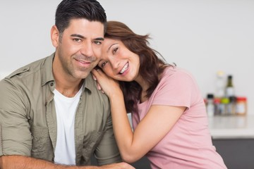 Portrait of a smiling couple in kitchen