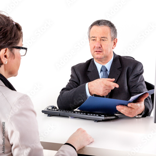 Businessman and businesswoman discuss business
