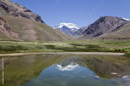 Aconcagua mountain reflected at a lake.