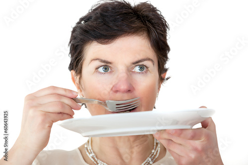 Woman with plate and fork in hand