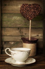 cup of coffee with a decorative topiary