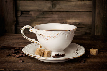 elegant coffee cup with beans and sugar cubes