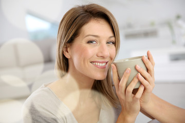Beautiful woman drinking hot tea