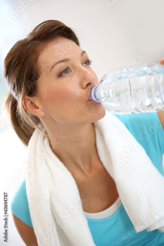 Portrait of fitness woman drinking water