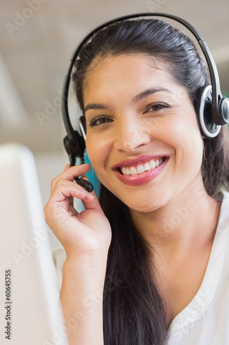 Smiling customer service representative wearing headset