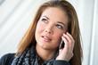canvas print picture - junge Frau mit Smartphone nachdenklich